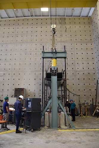 Preliminary results of the first of six physical tests on coupled steel-plate composite shear-wall specimens indicate excellent behavior and cyclic performance. (Photo: AISC)